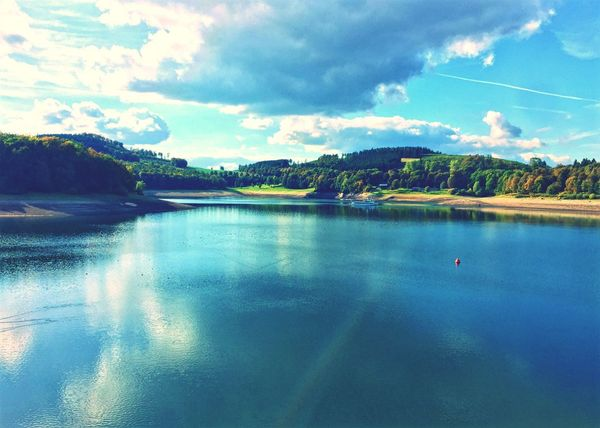 Hennesee, nrw Sky Water Cloud - Sky Nature Scenics Cloud Beauty In Nature Reflection Idyllic Mountain Tranquil Scene No People Tranquility Outdoors Waterfront Day Tree Architecture Bay Sea Germany