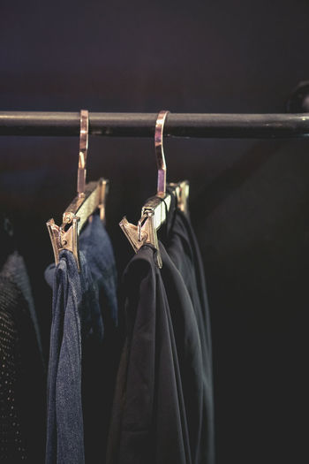 Close-up of clothes hanging on rack