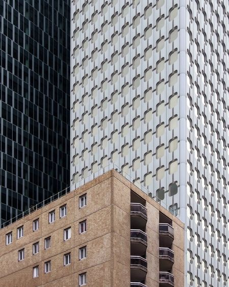 Congested TheWeekOnEyeEM Built Structure Building Exterior Architecture Building Low Angle View City Office Building Exterior Modern Office No People Tall - High Skyscraper Day Pattern Window Tower Outdoors Repetition Glass - Material The Architect - 2018 EyeEm Awards