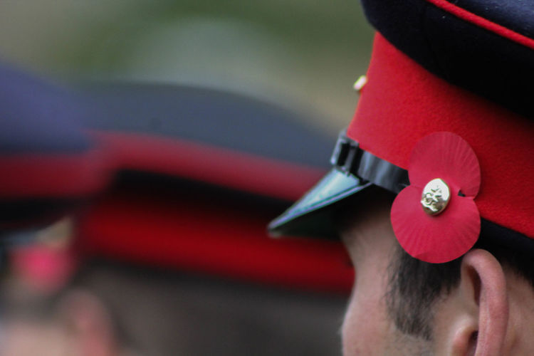 Cropped image of british army soldier wearing cap