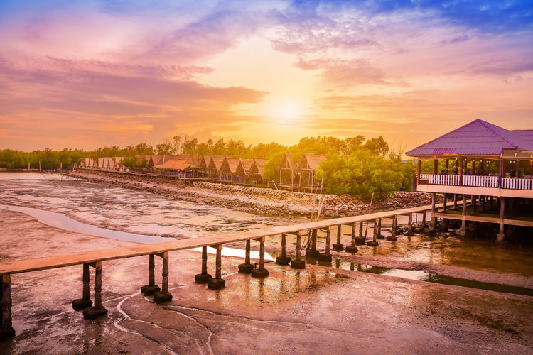 Beach at Samut Sakhon Thailand,Beautiful sunset nature background Architecture Beauty In Nature Building Building Exterior Built Structure Cloud - Sky Gazebo Land Nature No People Orange Color Outdoors Scenics - Nature Sky Sunlight Sunset Swimming Pool Tranquil Scene Tranquility Tree Water