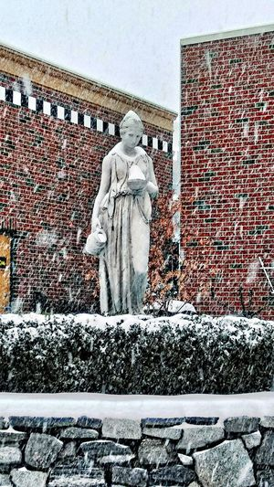 a bowl of snow ~ My Point Of View Winter Snow Winter Beauty  Happy Moment My Neighborhood Enjoying Life My City Loving The Landscape Storm Architecture In Portland Maine USA Creativity Day Outdoors Full Length No People Sky Statue Human Representation Female Likeness Building Exterior Brick Wall