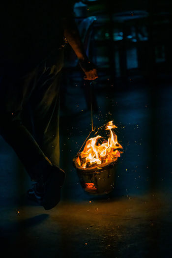 Person holding burning candles