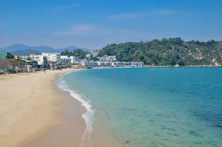 Cheung Chau HongKong Architecture Beach Beauty In Nature Blue Building Exterior Built Structure Cheungchau Clear Sky Day Mountain Nature No People Outdoors Sand Scenics Sea Shore Sky Tranquil Scene Tranquility Travel Destinations Tree Vacations Water Wave