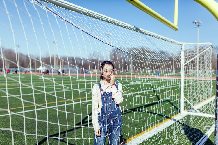 Young woman on soccer field