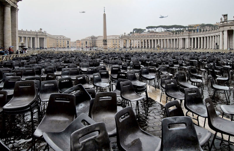 Empty Chairs At St Peter Square Against Sky