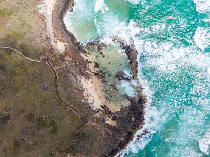 High angle view of coastline and sea