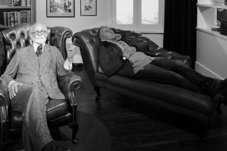 People relaxing on sofa at home