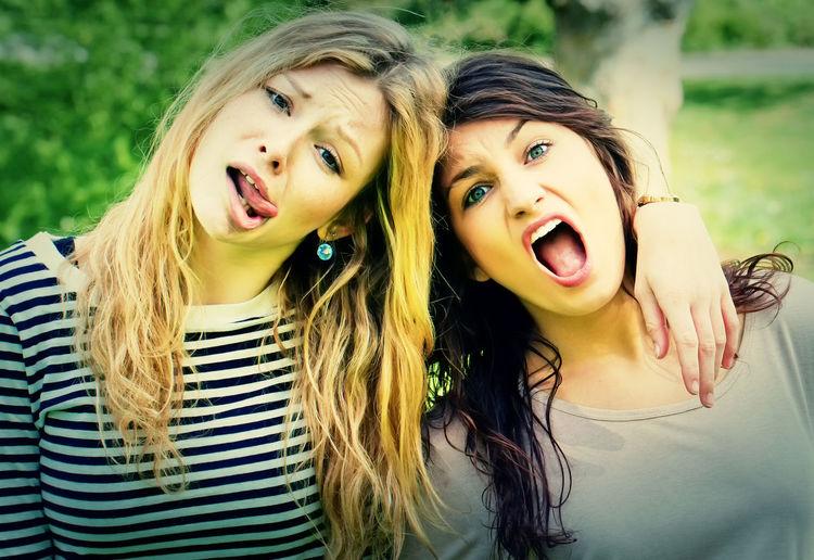 Portrait of female friends making faces
