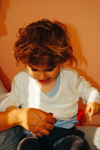 Girl sitting with mother at home