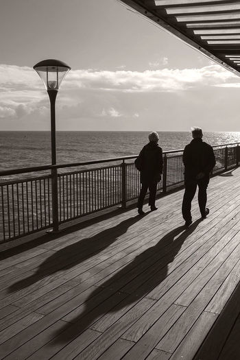 Long shadows on a cold and crisp day on Boscombe Pier. Dorset Fujifilm Black & White Beach Photography