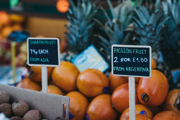Fruits on sale at a street market. Market Passion Fruit Sharon Fruit Local Food Groceries Wellness Five A Day Fruits Price Tag Fresh Food Market Street Market No People Retail  For Sale Freshness Wellbeing Food And Drink Food Healthy Eating Day Winter East London Retail  Retail Display