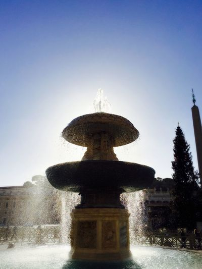 Fountain against clear sky
