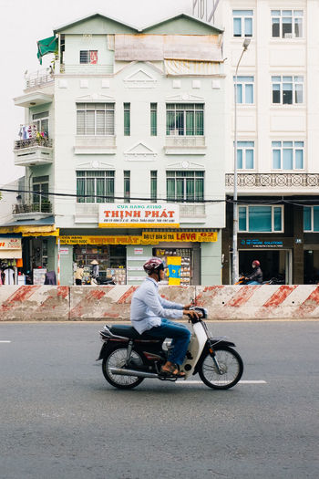 Driving by Fujifilm_xseries Vietnam Ho Chi Minh City Saigon Building Exterior Architecture Built Structure City Transportation One Person Full Length Mode Of Transportation Day Street Adult Bicycle City Life Casual Clothing Men Building Road Window Outdoors Riding