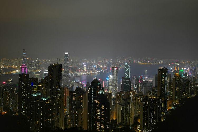 Illuminated hong kong cityscape against sky at night