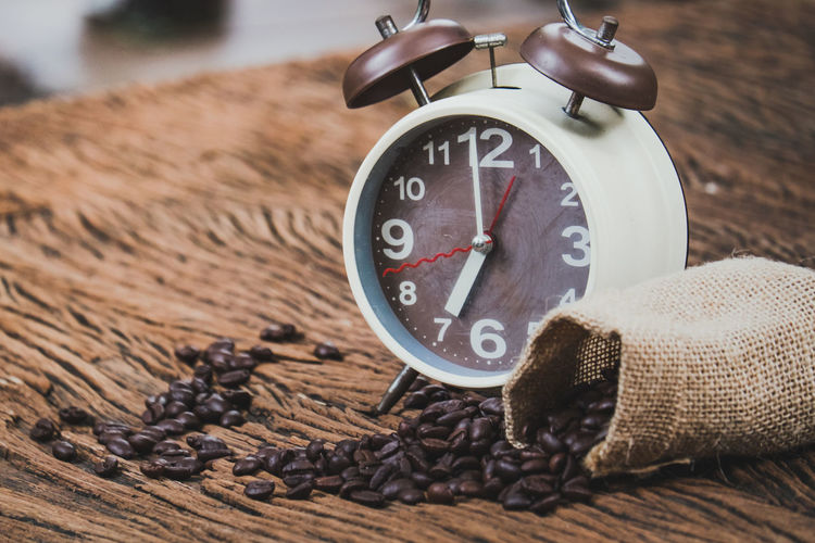 A brown alarm clock and coffee beans in a sack bag, on old wood table Alarm Arabic Arabica Aroma Aromatic Background Bag Beans Beverage Break Breakfast Brown Business Cafe Caffeine Cappuccino Casual Clock Coffee Dark Design Energy Expresso  Fresh Gourmet Grain Growth Idea Lifestyle Meeting Mocha Modern Morning Mug Relax Restaurant Shop Success Symbol Table