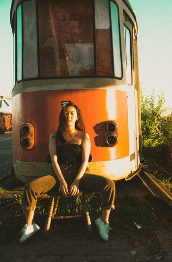 Portrait of man sitting on train