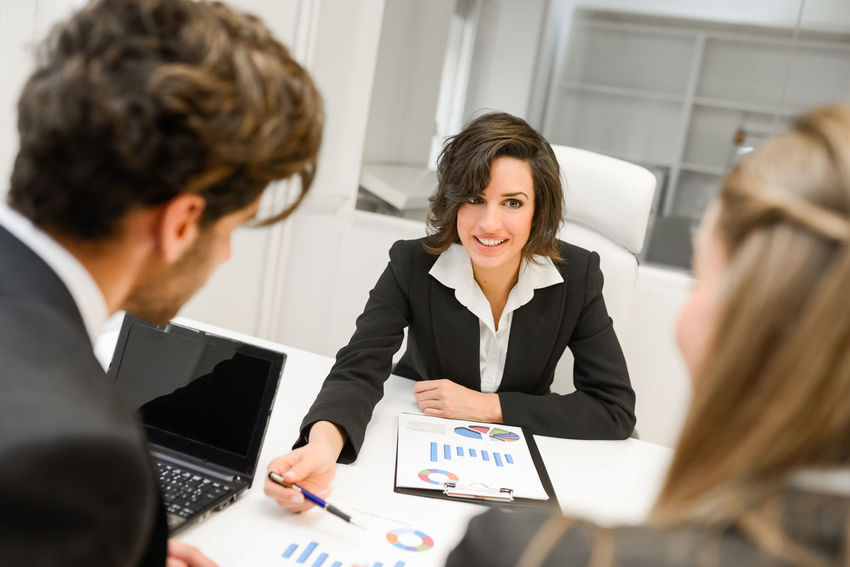 Image of business partners discussing documents and ideas at meeting Business Businessman Businesspeople Businesswoman Communication Corporate Business Customer  Day Indoors  Men Mid Adult Men Occupation Office People Real People Teamwork Technology Well-dressed Wireless Technology Women Working Young Adult Young Women