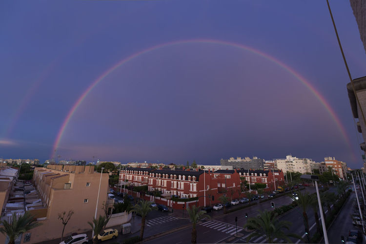 Double rainbow over the sky of the city of Elche in Spain. Alicante Elche Landscape Photography SPAIN Architecture Beauty In Nature Building Building Exterior Built Structure City Cityscape Colorful Day Double Rainbow High Angle View Landscape Multi Colored Nature No People Outdoors Rainbow Residential District Scenics - Nature Sky Urban Landscape