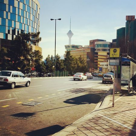 Architecture Car Built Structure Building Exterior Street City Land Vehicle Transportation Mode Of Transport Outdoors Day No People Road Sky Tree tehran Iran Tehran People Teheran Real People