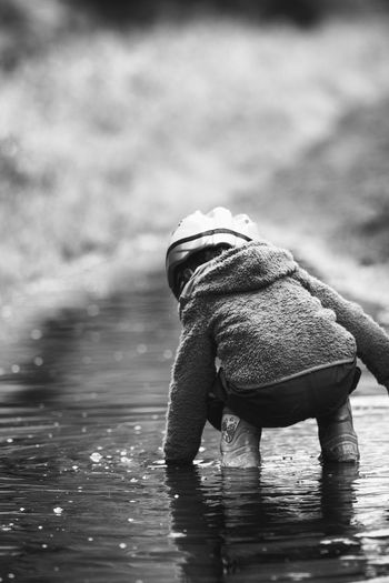 Puddle Kids Of EyeEm Children Family Fun Kids Kids Being Kids Kids Playing Touch Bending Child Childhood Children Only Girl Kid Kidsphotography Leisure Activity Nature One Person Outdoor Outdoors Playing Puddle Rear View Rubber Boot Water Wet EyeEmNewHere The Portraitist - 2018 EyeEm Awards
