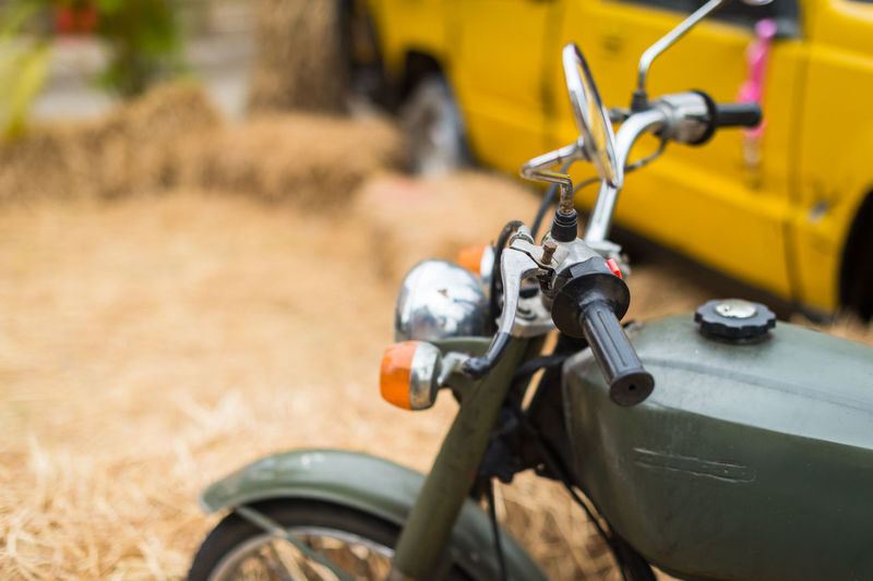 Close-up of bicycle parked on land