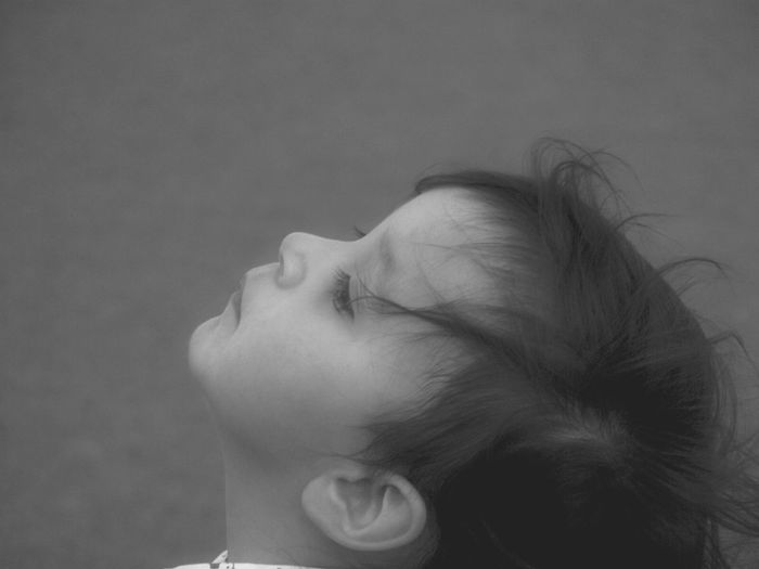 Kid Portrait Of A Child Portrait Of Innocence Relaxing Wind In My Hair Black And White Portrait EyeEm Best Shots - Black + White Capture The Moment Picturing Individuality Everyday Emotion Feel The Journey Original Experiences Girl Power Monochrome Photography