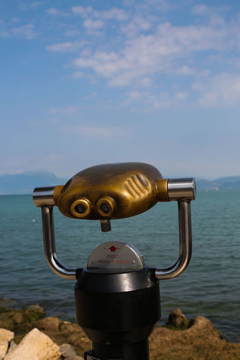 Lake Garda Astronomy Beauty In Nature Binoculars Close-up Cloud - Sky Coin Operated Coin-operated Binoculars Day Focus On Foreground Hand-held Telescope Metal Nature No People Outdoors Sea Security Silver Colored Sky Surveillance Tranquil Scene Water