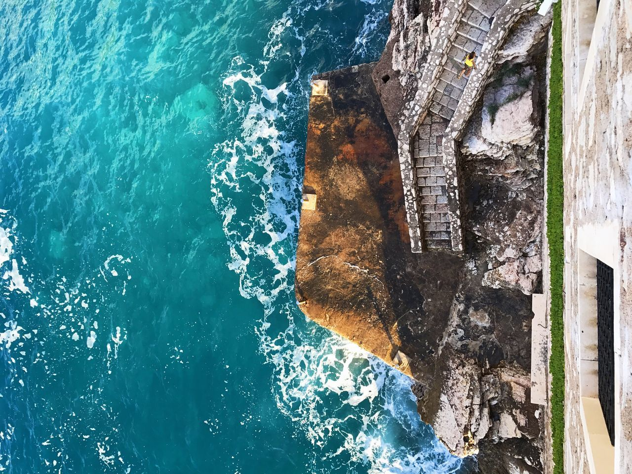 High Angle View Of Sea Against Blue Sky