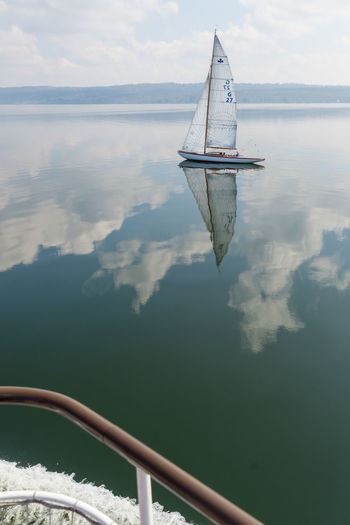 Sailboat on the calm water of Ammersee, Germany. Calm Calmness Reflection Travel Photography Cloud - Sky Clouds And Sky Day Nature Nautical Vessel No People Outdoors Sailboat Sailing Scenics Sea Ship Sky Tranquility Transportation Travel Destinations Water Waterfront
