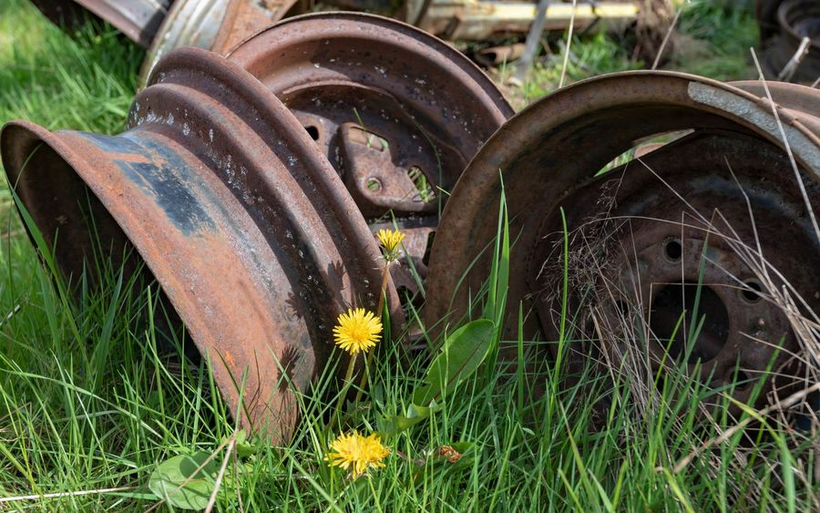 Abandoned Agricultural Equipment Damaged Day Deterioration Field Grass Green Color Growth Land Metal Mode Of Transportation Nature No People Obsolete Outdoors Plant Run-down Rusty Tire Transportation Wagon Wheel Wheel
