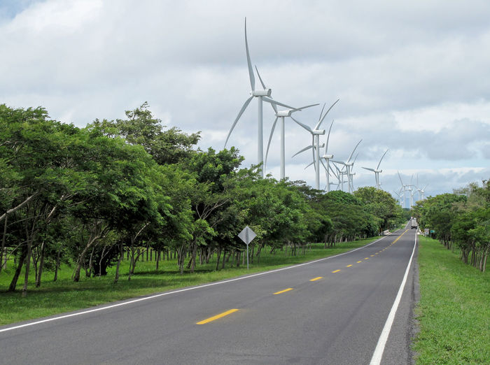 Power generation wind farm along the road, Nicaragua, Central America Power Turbine Electricity  Windmill Wind Turbine Energy Environment Environmental Road Transport Highway Streetphotography Asphalt Nicaragua Central America Generator Ecology Ecological Electric Fuel And Power Generation Wind Power Plant Electricity  Renewable Energy Environmental Conservation Wind Power Supply