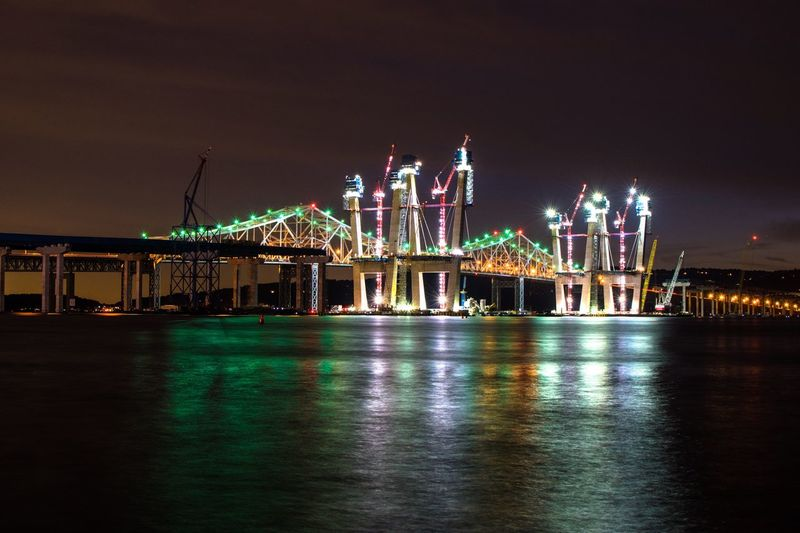 Illuminated Night Built Structure Architecture Lighting Equipment Travel Destinations Light - Natural Phenomenon Building Exterior Crane - Construction Machinery Electric Light Tourism Water Waterfront Development Sky Multi Colored Famous Place Outdoors Culture In Front Of