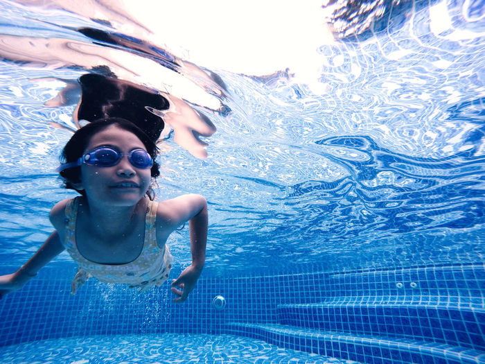 somersault child Diving in the pool Blue Eyewear Females Leisure Activity Lifestyles Nature One Person Outdoors Pool Real People Sea Swimming Swimming Pool Swimwear Underwater Water Women Young Adult Young Women
