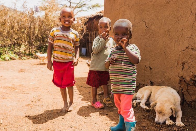 Children of the Maasai | Kenya Childhood Kenyanphotographer Kenya African Maasai Africa EyeEm Selects Animal Child Childhood Togetherness Looking At Camera Baby Full Length Dog Cute Family Standing Girls Boys Friendship Outdoors Cheerful Smiling People Press For Progress