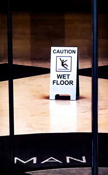 Going down Architecture Built Structure Capital Letter Communication Danger Don't Fall Dow Focus On Foreground Glass - Material Guidance Indoors  Information Information Sign No People Sign Slipping Symbol Text Western Script Wet Floor Sign