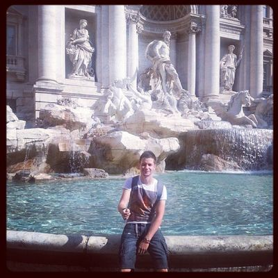 Tossing a coin into the Trevi Fountain Rome Italy TreviFountain Trevi Fountain Roma Tosser Holiday Sun