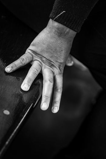 Close-up of hand touching seat