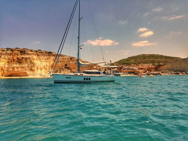 Sea Water Sailboat Vacations Nautical Vessel Yacht Beach Outdoors Travel Destinations Sailing Travel Blue Landscape Nature No People Scenics Sailing Ship Day Wave Tourism Travel Vacations Tranquility Tranquil Scene Beauty In Nature