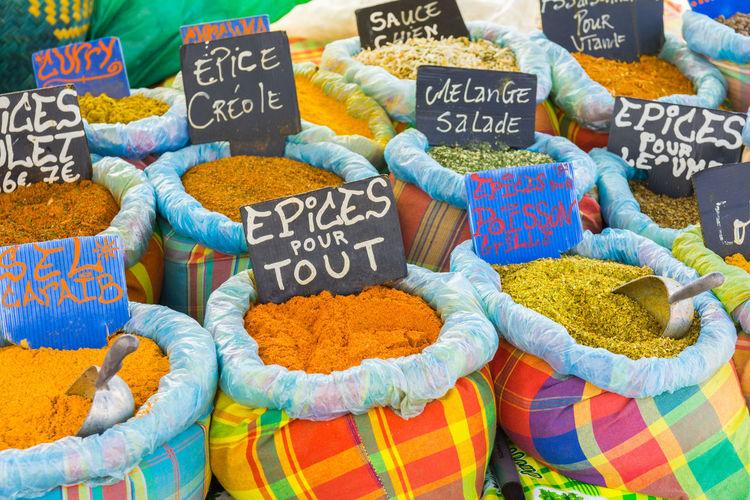 Various spices on a food market in Sainte-Anne, Grande-Terre, Guadeloupe Sainte Anne Guadeloupe Grande Terre Food Market Spice Spicies Spicy Various Choice Caribbean Island French France West Indies Colors Yummy Variety Bag Creole Cuisine Cooking Aroma Herb Local