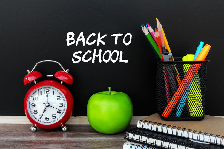 Back To School Black Board Apple Alarm Clock Pen Pencil Note Pad School Classroom Still Life Concepts Text Studio Shot Group Of Objects