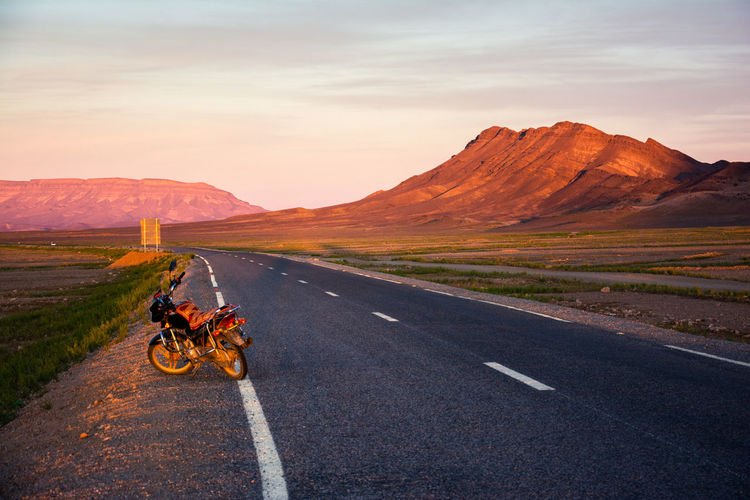 Let's go for a ride, shall we? Road Mountain Sky Mountain Range Motorcycle Ride Riding Scenics - Nature Travel Environment The Way Forward Landscape Road Trip Biker Outdoors Transportation Nature Real People Beauty In Nature Wanderlust Morocco Sahara Desert Text Space Exploring Sunset