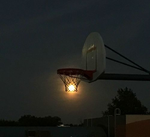 It's a Pisces Full Moon Slam Dunk! #fullmoon #basketball #awesomeness #3pointer Basketball Hoop Sunset Sky Low Angle View Basketball - Sport Moon Night The Creative - 2018 EyeEm Awards The Still Life Photographer - 2018 EyeEm Awards
