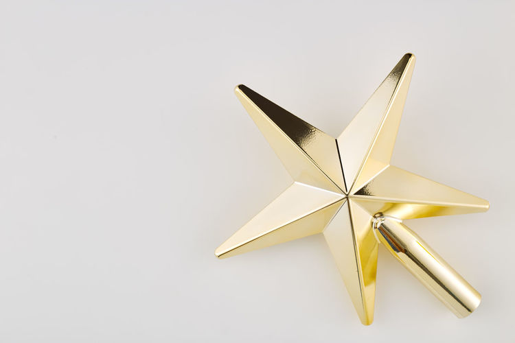 Studio Shot White Background Indoors  Star Shape Copy Space No People Shiny Still Life Gold Colored Paper Single Object Cut Out Christmas Close-up Creativity Celebration Two Objects Art And Craft Craft Shape