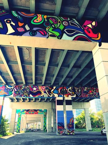 Toronto street art Art is Everywhere Explore Your City Murals Concrete Structure Painted Wall Streets Of Toronto EyeEmNewHere Toronto Street Photography Visual Communication Artistic Expression Bridge - Man Made Structure Street Art Underpass Urban Landscape Graffiti Art Multicolored Built Structure Architecture No People Day Multi Colored Pattern Outdoors Architectural Column Low Angle View