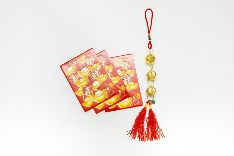 Angpao #HappyChineseNewYear #GongXiFaCai Angpow China Chinese Chinese Culture Chinese New Year Close-up Day Food Gray Background Hanging No People Red Studio Shot White Background