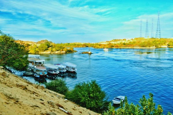 The Land Of Beauty Aswan ♥♥ Aswan Egypt Egyptian Art Tranquil Scene Photogtaphyinmotion This Is Egypt ❤ Beauty In Nature Outdoors Tree Blue Nile River Water Sky Travel Destinations No People Boats⛵️ Built Structure Architecture Cloud - Sky Scenics Nature Aswan, Egypt Tranquility Landscape