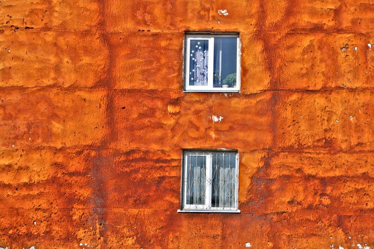 Close-up of window on brick wall