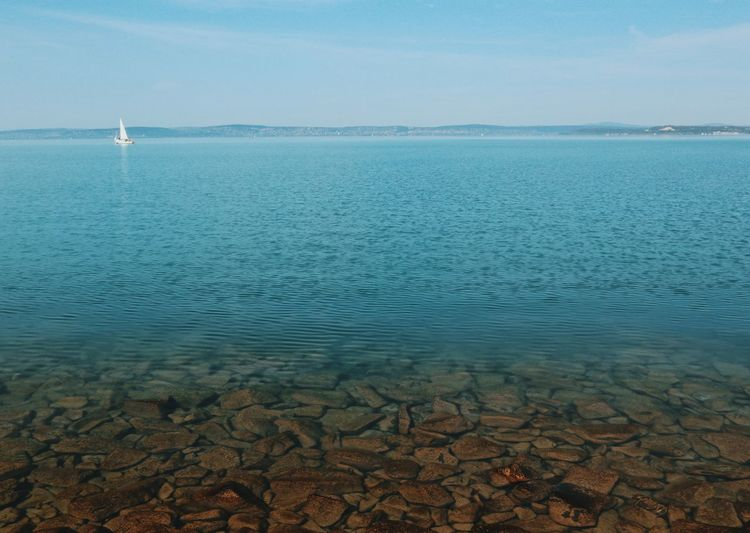 Hungary Balaton Beauty In Nature Boat Horizon Lake Lake View Lakeshore Lakeside Landscape Nature No People Outdoors Rocks Rocks And Water Scenics Tranquil Scene Tranquility Travel Destinations Water Perspectives On Nature