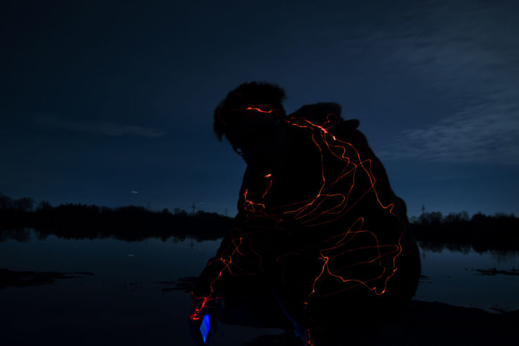 Friend Lake Lake View Laser Night One Man Only One Person Outdoors Reflection Silhouette Sky Smartphone Water